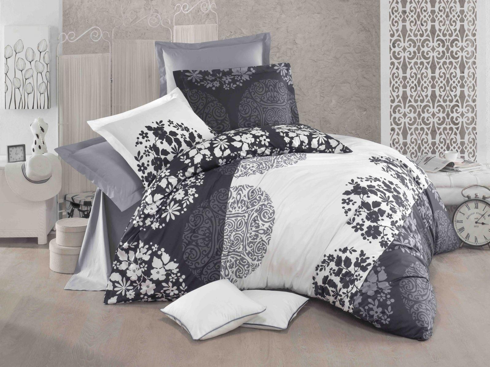 Povlečení z bavlny s květinovým ornamentem v bílé a černé barvě Kvalitex